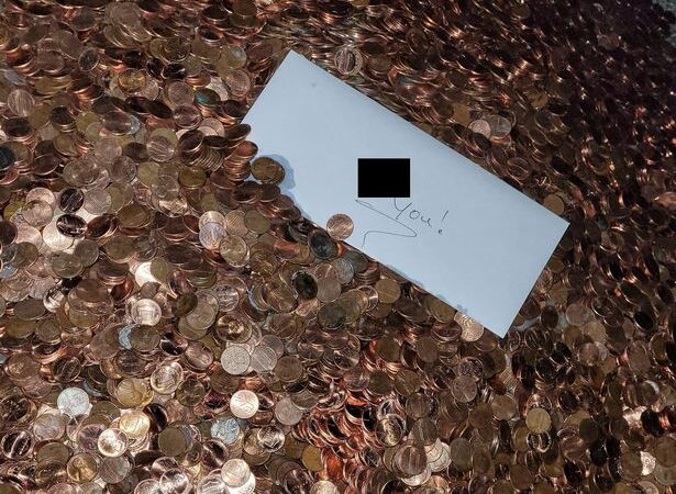 Garage worker gets last pay packet in 91,500 greasy pennies with 'f**k you' note